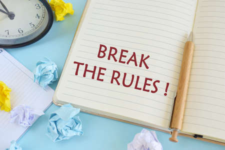 Writing note showing Break The Rules. Business photo showcasing To do something against formal rules and restrictions.Notebook with text Break the rules on bright blue background