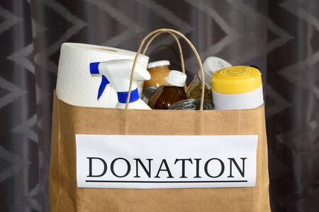 Close up of a donation bag with food and cleaning supplies ready to be delivered during the Covid-19 / Coronavirus Pandemic