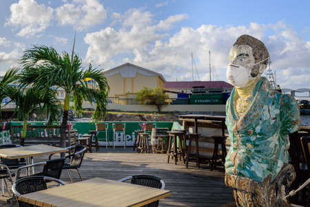 Sint Maarten, Caribbean. March 31st 2020. Normally busy this time of year, the bar mascot at the Sint Maarten Yacht Club Bar & Restaurant is alone while the business is closed due to the Pandemic during March, April and May.
