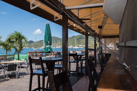 Sint Maarten, Caribbean. March 31st 2020. Shutters are down and the chairs and tables are empty at the Sint Maarten Yacht Club Bar & Restaurant while it is closed for the Pandemic during March, April and May 報道画像