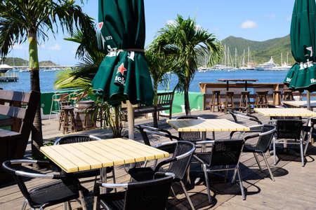 Sint Maarten, Caribbean. March 31st 2020. Normally busy, the outdoor deck is empty at the Sint Maarten Yacht Club Bar & Restaurant while it is closed for the Pandemic during March, April and May