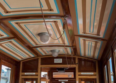 Old rail car: the elegant interior decor of an antique vintage train-tram