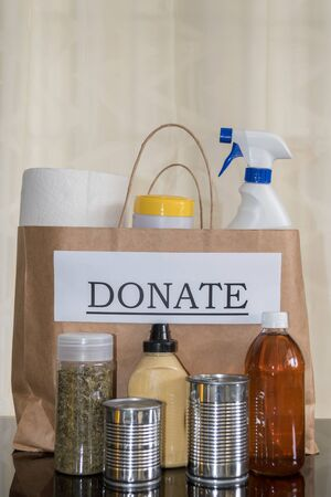 Preparation of a donation bag with food and cleaning supplies for people in need