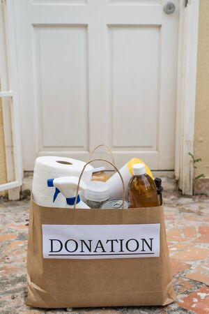 A donation bag filled with food and cleaning supplies is delivered to a home during the Covid-19 / Coronavirus Pandemic