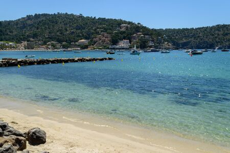 Crystal clear water at the beach in Port Soller, Spain 写真素材