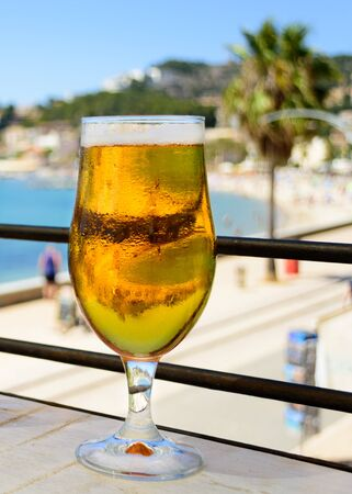 Enjoying happy hour with an ice cold beer on a hot summer day
