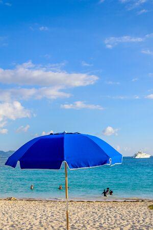 Bright blue beach umbrella in the Caribbean