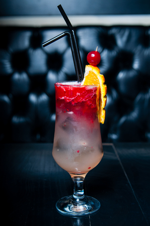 non alcoholic: Decorated red cocktail served on a black table, ready for consumption Stock Photo