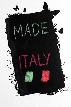 handwrite: Made in Italy handwrite on blackboard Stock Photo