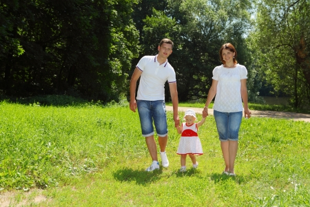 Happy family walking in the park  Summer sunny day  photo