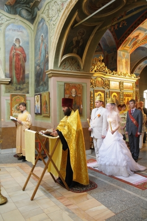 MOSCOW - AUGUST  04: Not identified people take part in wedding Christian orthodox church ceremony at Tsaritsino Cathedral on August 04, 2007 in Moscow. Editöryel