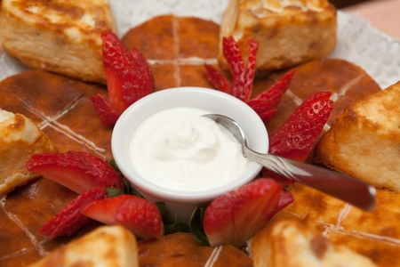Cottage cheese baked pudding, strawberry and sour cream in a plate photo