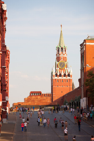 spasskaya: MOSCOW - JULY 29: Lenins Mausoleum, Spasskaya Tower and walking people on Red Square on July 29, 2014 in Moscow. Editorial