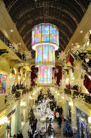 holiday lighting: MOSCOW - DECEMBER 21: Christmas decoration and illumination inside the GUM store on December 21, 2014 in Moscow. Editorial