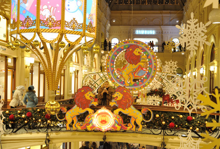 holiday lighting: MOSCOW - DECEMBER 21: Drawn lions, snowflakes and Christmas illuminations in GUM store on December 21, 2014 in Moscow.