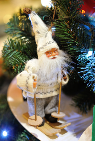 holiday lighting: MOSCOW - DECEMBER 21: Santa Claus toy against the Christmas tree in the GUM store on December 21, 2014 in Moscow. Editorial