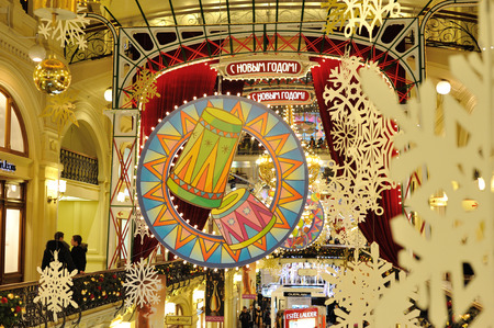 holiday lighting: MOSCOW - DECEMBER 21: Drawn drums, snowflakes and Christmas illuminations in GUM store on December 21, 2014 in Moscow. Editorial
