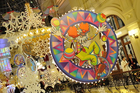 december 21: MOSCOW - DECEMBER 21: Drawn clown, snowflakes and Christmas illuminations in GUM store on December 21, 2014 in Moscow. Editorial