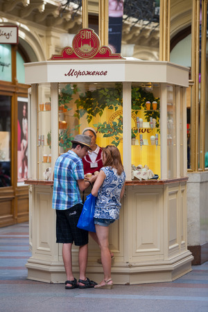 large store: MOSCOW - JULY 29: Young man and woman buying ice cream at the GUM store on July 29, 2014 in Moscow. GUM is the large store in the Kitai-gorod part of Moscow facing Red Square.