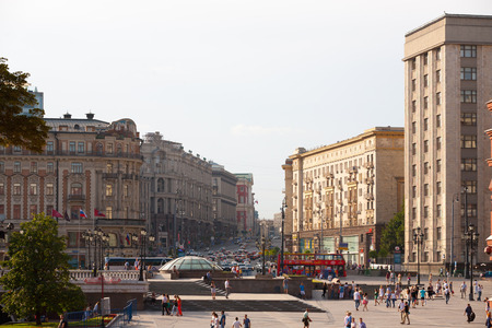 MOSCOW - JULY 29: People walking on Manezh Square on July 29, 2014 in Moscow. Tverskaya Street is in the background.