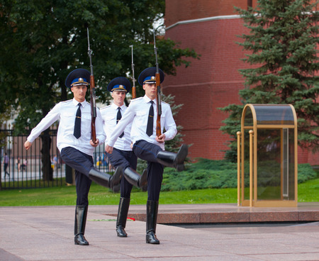 tomb of the unknown soldier: MOSCOW - JULY 29: Three soldiers taking part in Changing of Honor Guard Ceremony near Tomb of Unknown Soldier in Alexander Garden on July 29, 2014 in Moscow. This Tomb is war memorial, dedicated to Soviet soldiers killed during World War II.