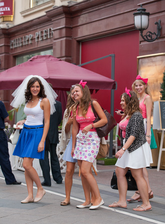 bachelorette party: MOSCOW - JULY 29: The bride and young girls taking part in a bachelorette party before wedding on St. Nicholas Street on July 29, 2014 in Moscow. Editorial