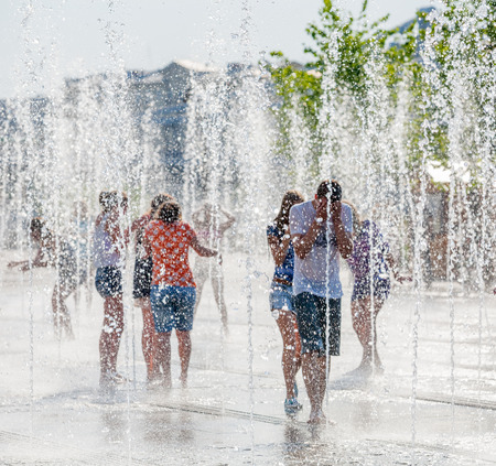 MOSCOW - JULY 31: Young people bathing in dry fountain in Museon Park on July 31, 2014 in Moscow. Editöryel