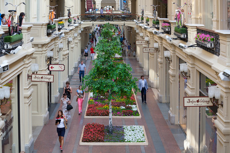 large store: MOSCOW - JULY 29: Artificial trees and balconies decorated bicycles in the GUM store on July 29, 2014 in Moscow. GUM is the large store in the Kitai-gorod part of Moscow facing Red Square.
