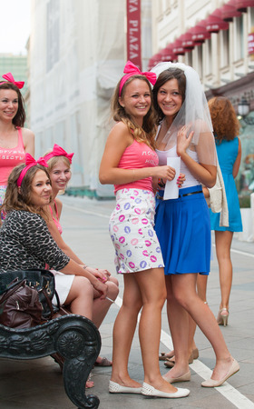 MOSCOW - JULY 29: The bride and young girls taking part in a bachelorette party before wedding on St. Nicholas Street on July 29, 2014 in Moscow. Editöryel