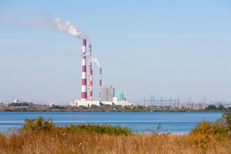 rive: NOVOMICHURINSK, RUSSIA - SEPTEMBER 16: Ryazan Power Station Building on Pronya Rive on September 16, 2014 in Novomichurinsk city. Ryazan Power Station is the fifth largest oil-fired power station in the world. Editorial