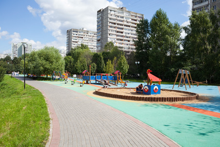 administrative buildings: MOSCOW - AUGUST 2: Playground and residential buildings in Heritage Village Park in Bibirevo district on August 2, 2014 in Moscow. Bibirevo is administrative district of North-Eastern part of Moscow, Russia. Editorial