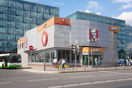 MOSCOW, RUSSIA - July 13, 2018: KFC restaurant building, people and bus on Leningradskoye Highway. This building is located near Voykovskaya metro station.