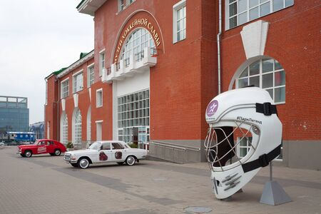 MOSCOW, RUSSIA - SEPTEMBER 10, 2018: Goalkeepers helmet and cars near the Hockey Glory Museum at Avtozavodskaya Street. This museum was founded in 2016.