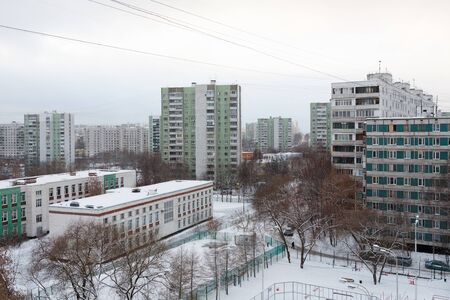 MOSCOW, RUSSIA - DECEMBER 6, 2019: Top view on apartment buildings and school building in Belozerskaya street on winter day. Belozerskaya street is located in Bibirevo district in north of Moscow.