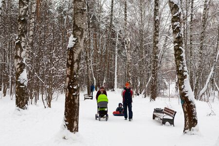 MOSCOW, RUSSIA - DECEMBER 6, 2019: People walking in Lianozovsky Nursery park in Leskova street on a winter day. Leskov Street is located in Bibirevo district in the north of Moscow.
