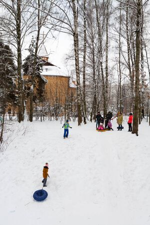 MOSCOW, RUSSIA - DECEMBER 6, 2019: Citizens resting in Lianozovsky Nursery park in Leskova street on a winter day. Leskov Street is located in Bibirevo district in the north of Moscow. Editöryel