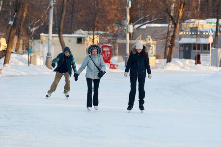 MOSCOW, RUSSIA - JANUARY 23, 2019: People skating in Sokolniki Park on winter sunny day. Sokolniki Park is not far from center of city, near Sokolnicheskaya Gate.