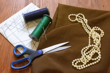 schemes: macro composition fabric for sewing beads scissors chalk threads patterns schemes Stock Photo