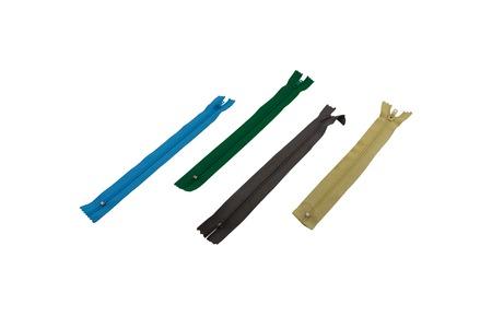 fastener: macro four multi-colored zipper locks of a fastener isolate on a white background Stock Photo