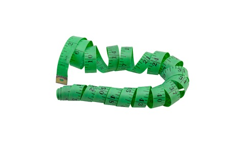 sartorial: green measuring tape for sewing and needlework isolated over white