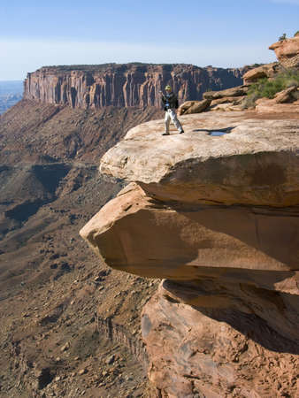 Hiker goes to the edge to take a photo