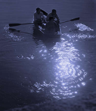 exploit: Reflections play on the wake left by a small boat