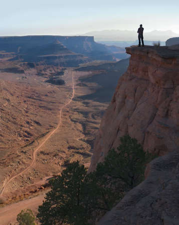 daring: Daring hiker admires Canyonlands and the distant Colorado River Stock Photo