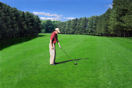Golfer prepares a fairway shot on a well-manicured course