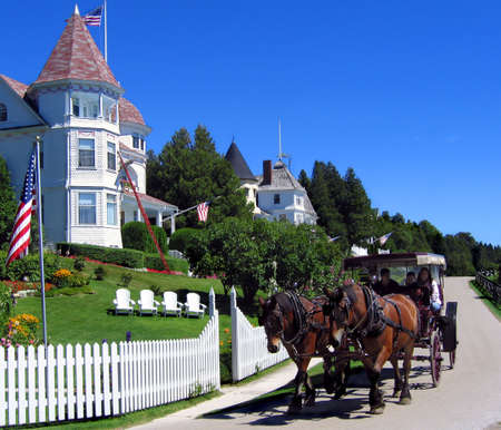 Horses are the only form of transportation allowed on Mackinac Island. This is one of the many horse drawn carriages Stock Photo - 336412