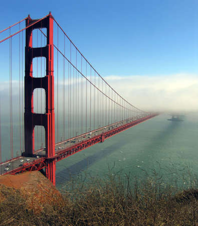 bridging: Afternoon fog obscures one tower of the Golden Gate Bridge Stock Photo