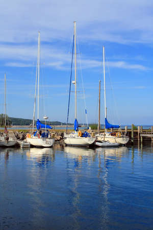 Sailboats at rest on a summer afternoon in Michigan Reklamní fotografie