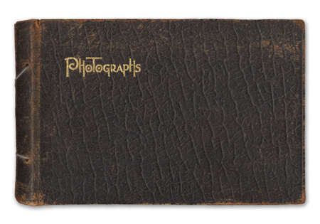 Vintage leather-bound photograph album isolated on white background