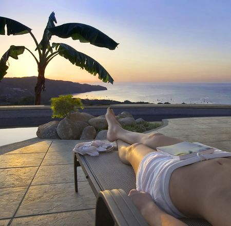Poolside view of the sun setting over the ocean in Costa Rica