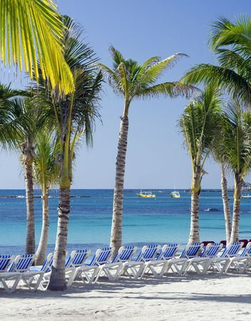 Clear skies and early morning sun on the beach in Cancun